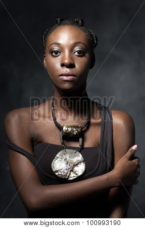 Confident African Woman With An Ethnic  Necklace
