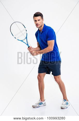 Full length portrait of a young man playing in tennis isolated on a white background