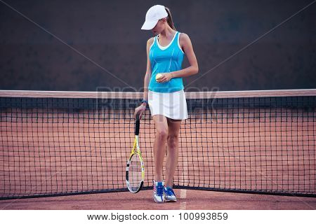 Full length portrait of a girl playing in tennis