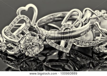 Various Women's Gold Jewelry. Sepia