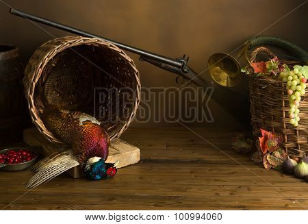 Hunting still life with pheasant, basket and fruit