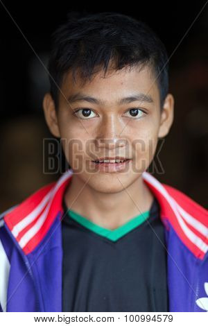 MANDALAY,MYANMAR,JANUARY 17, 2015 : Portrait of a young boy, son of a seller, posing in the central street market of Zegyo, in Mandalay, Myanmar (Burma).