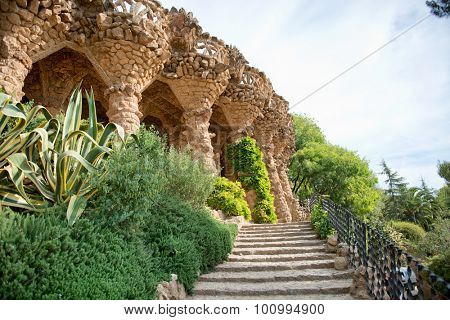 BARCELONA, SPAIN - MAY 02: Sloped columns and covered walkway at the Guell Park, Barcelona, Spain which are the load bearing supports for the viaduct on the el Carmei Hill. May 02, 2015