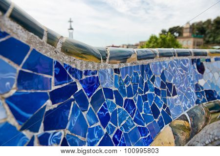 BARCELONA, SPAIN - MAY 02: Detail of bright blue ceramic mosaics on the curving wall on the main terrace, Parc Guell, Barcelona, Spain. May 02, 2015