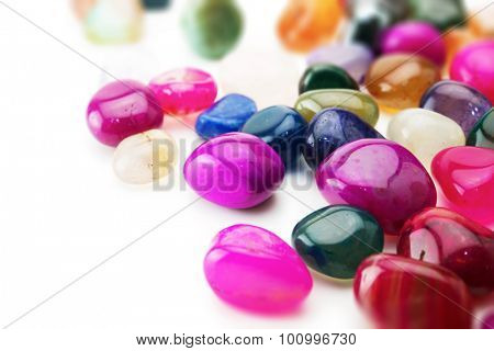 colorful natural gem stones, isolated on white.