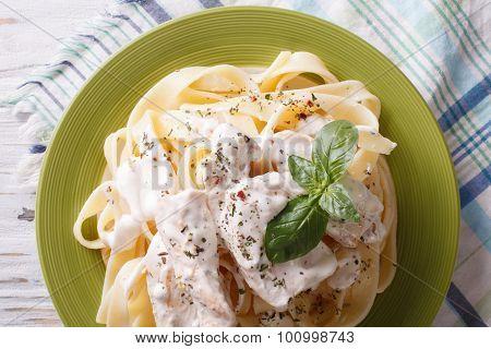 Alfredo Pasta In Cream Sauce With Chicken Closeup. Horizontal  Top View