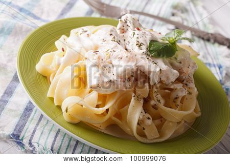 Pasta Alfredo With Chicken And Cream Sauce Close-up. Horizontal