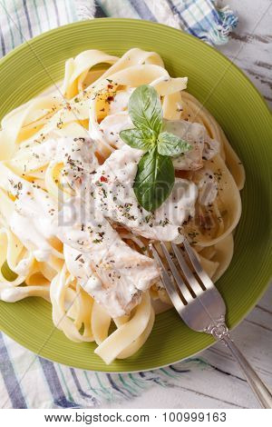 Fettuccine Alfredo Pasta With Chicken Closeup. Vertical Top View