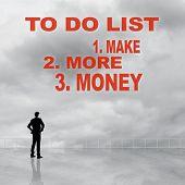 Постер, плакат: To Do List Make More Money sign or slogan on sky