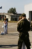 image of reunited  - soldiers meeting with their girlfriends hugging and kissing - JPG
