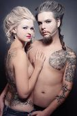 stock photo of marquise  - Pierced tattooed man and woman with old - JPG