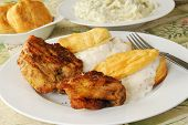 picture of biscuits gravy  - A plate of grilled chicken with biscuits and pepper gravy - JPG