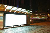 stock photo of bus-shelter  - Blank ad billboard on bus stop at night - JPG