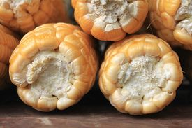 stock photo of corn cob close-up  - ripe corn on brown background close up - JPG