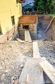 stock photo of foundation  - Construction site and formwork for the concrete fence in a family house terrace - JPG