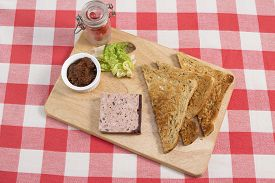image of canard  - Ardennes pate on a wooden board with pickle - JPG