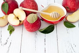 foto of traditional  - Apple and honey traditional food of jewish New Year  - JPG
