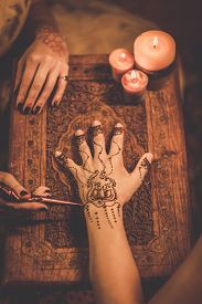 foto of vedic  - Drawing process of henna menhdi ornament on woman - JPG