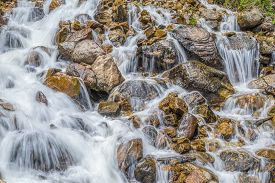 picture of gushing  - Water gushing over rocky river bed in one of the narrows of the Fraser River - JPG