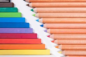 foto of pastel  - View of different color pencils and chalk pastels isolated on the white background - JPG