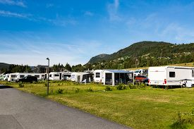 stock photo of caravan  - Group of modern campervans and caravans at campsite in central Norway on a sunny summer day - JPG