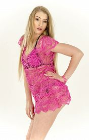 foto of tunic  - A girl in a light pink transparent tunic dress fun - JPG