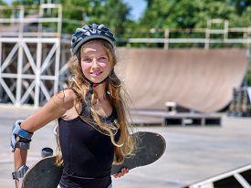 picture of skateboard  - Teen skateboarding his skateboard outdoor - JPG