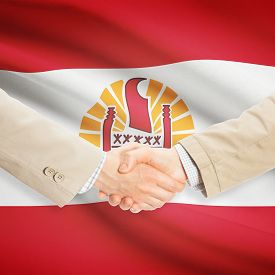 image of french polynesia  - Businessmen shaking hands with flag on background  - JPG