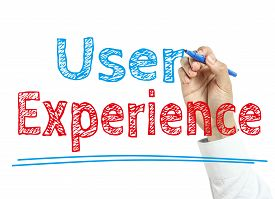 stock photo of experiments  - Man is writing text User Experience with marker on transparent wipe board - JPG