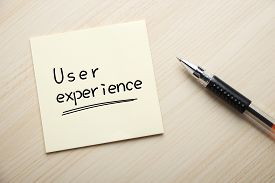 stock photo of experiments  - Text User Experience written on the sticky note with pen aside - JPG