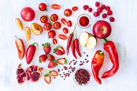 stock photo of pomegranate  - Collection of fresh red toned vegetables and fruits raw produce on white rustic background - JPG