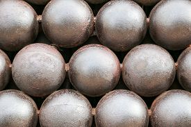 pic of cannon-ball  - Cannon Balls arranged in a pile background - JPG