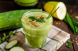 stock photo of smoothies  - Cucumber smoothie with herbs and chili flakes sweet and spicy smoothie with mint - JPG