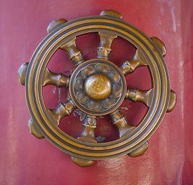 stock photo of dharma  - Wheel of Dharma one of eight auspicious Buddhist religious symbols in Japanese temple - JPG