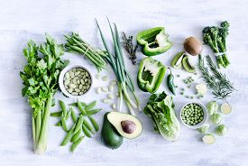 image of pea  - Collection of green produce from farmers market on rustic white background from overhead - JPG