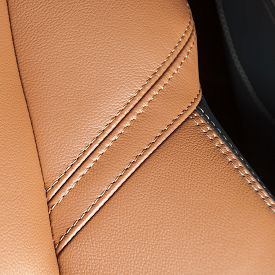 stock photo of stitches  - orange car leather interior details with stitch - JPG