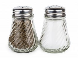stock photo of salt shaker  - Transparent glass shakers with salt and pepper isolated on white background - JPG