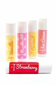 pic of flavor  - An assortment of five flavoured lip balms arranged in a line. Isolated on a white background. ** Note: Soft Focus at 100%, best at smaller sizes - JPG