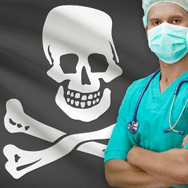 stock photo of skull crossbones flag  - Surgeon with flags on background  - JPG