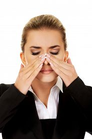 pic of sinuses  - Young businesswoman with sinus ache - JPG