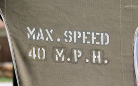 "stock photo of mph  - "" Max Speed 40 MPH"" canvas on Army car - JPG"