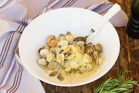picture of shell-fishes  - Clam shell fish in big white plate - JPG