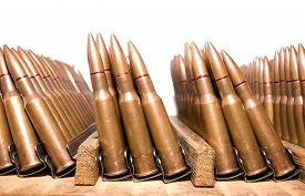 stock photo of gunshot  - These combat gunshot old rifle rounds in the cage on a white background - JPG