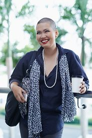 pic of shaved head  - Portrait of beautiful Asian woman with shaved head standing outdoors - JPG