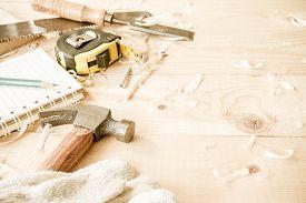 picture of chisel  - carpenter toolshammermeternailsshavings and chisel over wood table - JPG