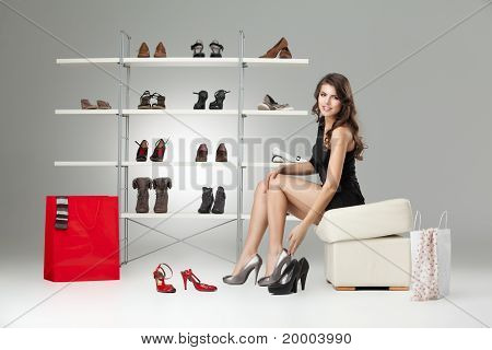 Young Woman Trying On High Heels