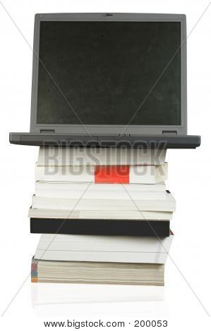 Business Laptop On Top Of Books