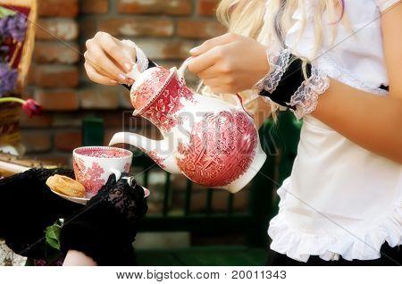 Maid serving a tea