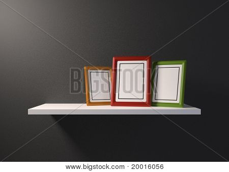 Bookshelf with an empty photo frame