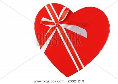 Topside of a heart shaped gift box with a ribbon